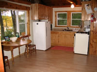 CLICK TO ENLARGE - picture of inside of living and dining area Twin Waters Rentals in St. Germain Wisconsin on Little St. Germain Lake
